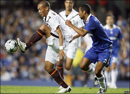 Yoan Gouffran is marked by Ashley Cole
