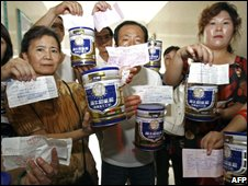 "A group of Chinese parents gather at a Sanlu milk powder distributor office to try to get refunds for the milk they bought only to find the office closed, in Wuhan, central China""s Hubei province on September 16, 2008"