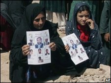 Afghans grieve over family members allegedly killed in a US air strike