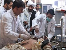 Afghan doctors treat a civilian casualty