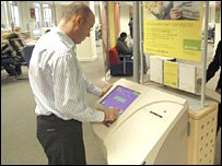 A man searching on a Jobpoint computer terminal
