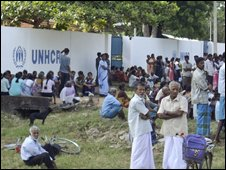 Internally displaced Sri Lankan ethnic Tamils sit outside the UNHCR compound during a protest against the departure of aid agencies, in rebel-held town of Kilinochchi, Sri Lanka, Friday, Sept. 12, 2008.