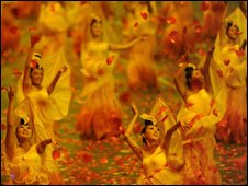 Petals fall on dancers inside the Bird's Nest