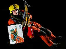 RAF search and rescue winchman holds 81 pence stamp showing crew member from 1984