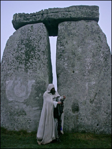 A man in robes at Stonehenge