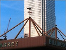 Billingsgate Fish market in the shadows of Canary Whafr building