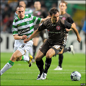 Saganowski looks to bring the ball away from Celtic's Scott Brown