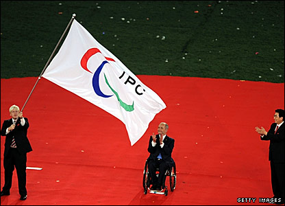 London Mayor Boris Johnson (left) waves the Paralympic flag