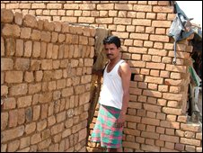 Man stands outside his new toilet block