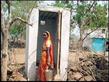 Woman outside a modern toilet