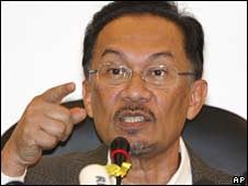 Anwar Ibrahim demands emergency parliamentary session at his party headquarters in Kuala Lumpur on Thursday