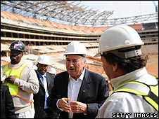 Sepp Blatter with stadium workers at Soccer City Stadium, Johannesburg
