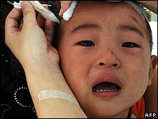 A child receives treatment after drinking tainted baby milk in Hefei, eastern China, on 18 September