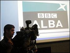 Cameraman and BBC Alba logo