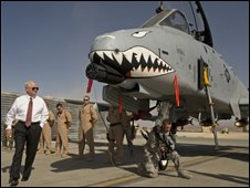 Robert Gates (in shirt and tie) visits US combat pilots at Bagram air base, Afghanistan, on 17 September