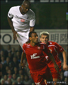 Darren Bent powers over two defenders for the winning goal