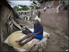 Taian Joseph by her destroyed house