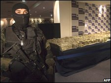 Mexican soldier guards drugs cash