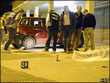 Police inspect the scene of one of the shootings in Caserta. Photo: 18 September 2008