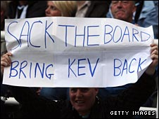 A Newcastle fan protests against Mike Ashley