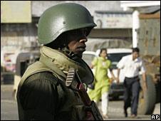 A Sri Lankan soldier stands guard in Vavuniya, northeast of Colombo, on 16 September 2008