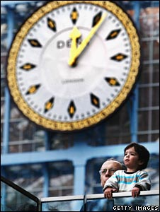 Man holds up a child to look at trains at St Pancras