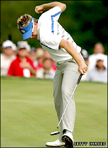 Ian Poulter celeberates as a crucial putt drops