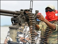 A Mend fighter with a heavy machine-gun in the Niger Delta, 17 September 2008
