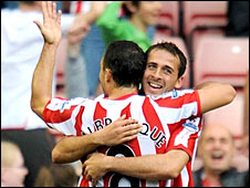 Michael Chopra (r) celebrates his second goal with Steed Malbranque