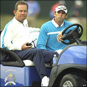 Sergio Garcia watches Saturday's foursomes from a gold cart with Europe's caddie master  Dave McNeilly