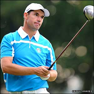 Padraig Harrington looks on anxiously as he watches a drive during his match