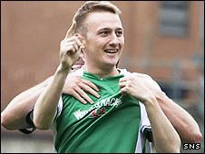 Hibs striker Derek Riordan celebrates his first half strike