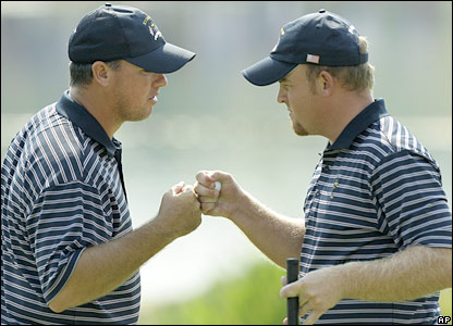 US stars Boo Weekley and JB Holmes celebrate a crucial putt in reguation fashion