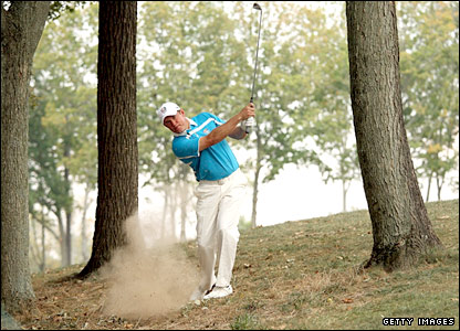Lee Westwood has to hit out of the trees after getting into difficulty at the 12th