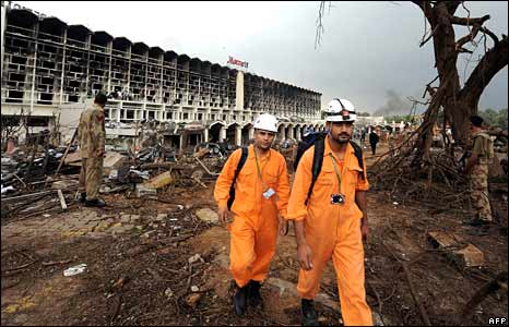 Pakistani rescue workers at Marriott Hotel bomb site, Islamabad
