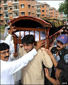 Pakistani relatives and residents carry the coffin of a victim of the Marriott bomb blast in Islamabad