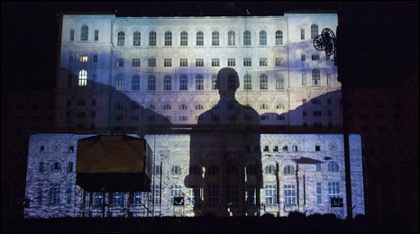 An image projected onto the Romanian Parliament building