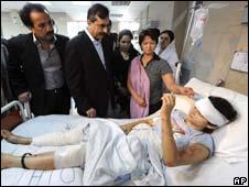 Pakistan's Prime Minister Yusuf Raza Gillani visiting injured in hospital