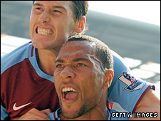 John Carew celebrates with Gareth Barry