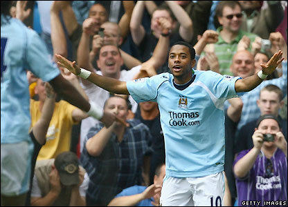 Robinho celebrates making it 3-0