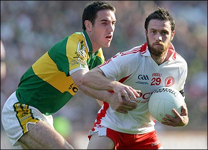 Kerry's Declan O'Sullivan attempts to halt the progress of Tyrone opponent Martin Penrose