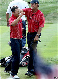 Anthony Kim is congratulated by his captain Paul Azinger after sealing a vital point for the US