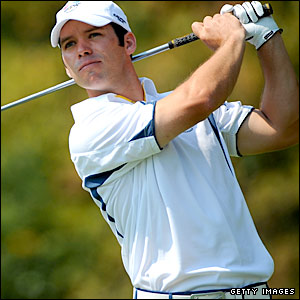 Paul Casey watches his drive fly down the fairway