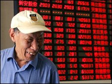An investor in front of the stock price monitor