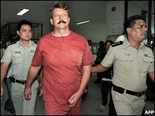 Alleged arms dealer Viktor Bout arrives at the Criminal Court in Bangkok on Monday
