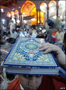 A boy prays at the Imam Hussein shrine in Karbala, Iraq