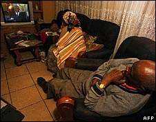 South Africa family watching Thabo Mbeki's resignation speech