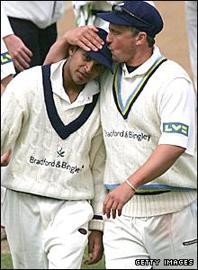 Darren Gough kisses Adil Rashid on the head