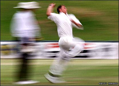 Darren Gough bowls for England