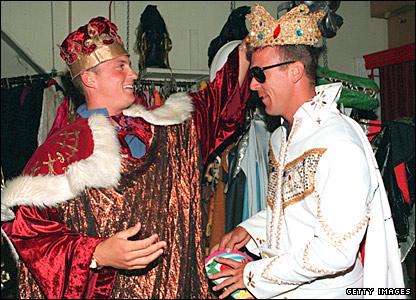 A crowned Darren Gough decks out team-mate Alec Stewart during a fancy dress party in Australia